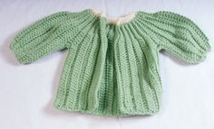 Crocheted baby sweaters by Njambi Ndiba Photography for KES 400.00