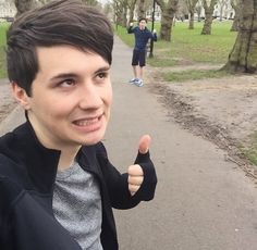"""Dan and Phil actually doing exercise! They are probably wearing their shoes that Say """"FML"""" and """"Kool Shoes"""""""