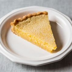 Lemon Pie Recipe - 1 large Meyer lemon, cut into 8 pieces (remove seeds), 1 1/2 cups sugar, 1 stick butter, 1 teaspoon vanilla, 4 eggs.  Place all in blender until smooth, pour into pie crust, and bake at 350 for 40 minutes. I followed this recipe with no vanilla, but the vanilla would be great in it, I'm sure.  Crust:  1/3 cup water, 1/3 cup oil, 1 cup flour.  Bring water and oil to a boil. Remove from heat and immediately add flour.  Stir to form dough, and press into pie plate.