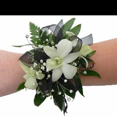 Prom corsage.  Flowers of Charlotte loves this!  Visit us at flowersofcharlotte.