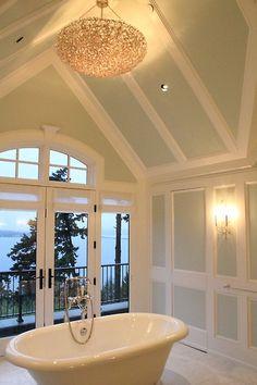 Love the color of these walls for a bathroom - really pairs nicely with white trim. That tub is to die for! ♥ Click this pin to see the bonus room in this home - they used a map as the wallpaper!