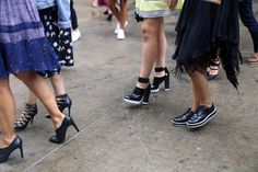 Stripes, Trench Coats and Rain: The Best Street Style From Day 1 of Fashion Week - Fashionista