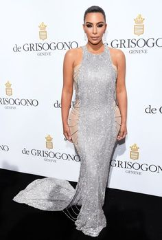 Kim Kardashian made her Cannes debut in Lan Yu Couture. Draped in crystals, Kardashian stunned at the de Grisogono party. Check it out!
