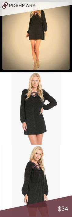 Super Cute Heather Knit Dress Embroidered Heather Knit Dress. In Black. (Also available in maroon in separate listing.) Mini. Loose fit. 95% Polyester 5% Spandex. Brand new listing available soon. We will take holds. Comment size for hold & we'll tag you when it's ready! Dresses Mini
