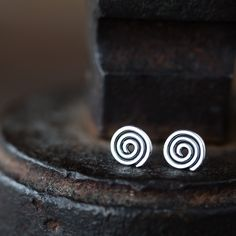 Tiny hammered Celtic spiral studs handcrafted with a great attention to detail and aesthetics of this timeless shape. Spiral is the one of the oldest symbols used by mankind and today it's as alive an