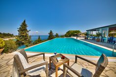 Set amid cypress trees and olive groves, in the fishing village of Loggos, Glyfada Beach offers traditional villas with panoramic Ionian Sea views. Paxos Island, Heraklion, Beach Villa, Holiday Accommodation, Luxury Holidays, Small Island, Travel And Tourism, Greek Islands, Holiday Travel