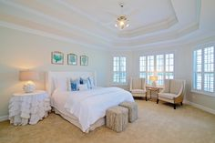 The serenity of this room makes relaxing at home a reality. With an add of charter the high ceilings draws your attention to the beautiful space. Enjoy a book in the reading space next to the windows that draws the natural light in.