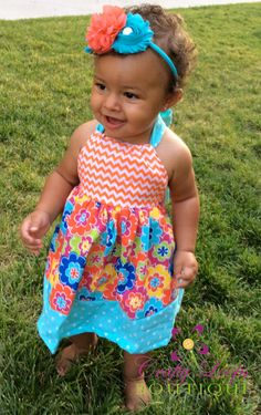 Summer toddler girl halter top ruffle dress with colorful flower pattern, orange chevron pattern and turquoise polka dot accents