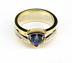 A Tanzanite, Diamond and 14 Karat Gold Ring. : Lot 1657168
