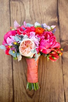 wedding bouquet with fuchsia, pale pink, hot orange and cool blue