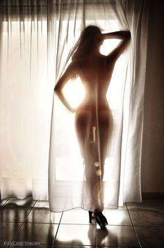Boudoir..I would crop the shoes out because the curtain doesn't cover them, it's weird with them sticking out like that