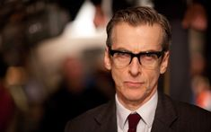 Photos of Peter Capaldi that my wife keeps open on the desktop while working dot tumblr dot com.