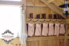 Bride's dress with pink short bridesmaid's dresses and boots in barn for country wedding Photography: www.TheAthensWeddingPhotographer.com Planning, Floral, and Event Design: www.WildFlowerEventServices.com Venue: Dillard, Ga