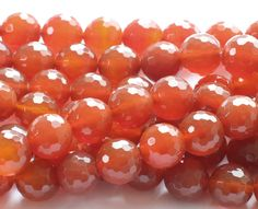 Carnelian faceted round beads (16mm, about 24 beads)