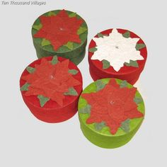 Poinsettias for the winter holidays, crafted in handmade silk paper. Assorted poinsettias of red and white, on green and red circular boxes. Handcrafted in Bangladesh.  $6