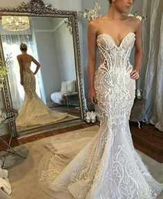Pretty lace wedding dress with a sweetheart neckline.