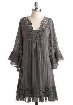 This smokey grey, 100% cotton frock will showcase your smouldering beauty thanks to its crocheted lace collar, belled sleeves, ruffly, lace-trimmed bottom, and subtle stripes. It comes with a coordinating slip with adjustable spaghetti straps, so the semi-sheer upper will only show sexy peeks of skin at the shoulders and arms.