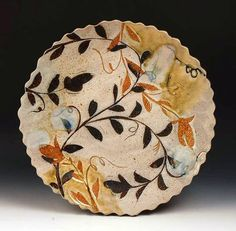 Michael Kline Pottery - Love this multi colored design. It'd be a great decoration for fall!