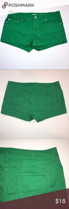 """Indigo Rein Emerald Green 2"""" Cotton Shorts Size 11 Emerald green shorts by Indigo Rein. Size 11. Button and zip fly closure.  5 pocket style with side slits.  98% Cotton 2% Spandex.  Approximate Measurements:  Waist Flat Across - 16.75"""", Hips Flat Across - 19"""", Leg Opening - 11.5"""", Inseam - 2"""", Front Rise - 8.5"""", Back Rise - 13.5"""". Excellent gently loved condition with minimum fading and from a smoke free home. Indigo Rein Shorts"""