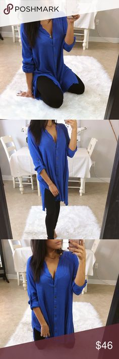 Dolphin oversized button up tunic top Such a pretty and vibrant blue for your pop of color💙 super easy top for anytime. Very versatile tunic with it's longer sleeves that can be buttoned up (as pictured) or worn down. Longer length; can be worn tucked into cutoff shorts for your spring look. Side slits.  _Boutique Brand _My Stats- 5', 106lbs 34-26-36 _Modeling Size-S _Prices are Firm. _Material-  _Fit- oversized, flowy fohxx Tops Tunics