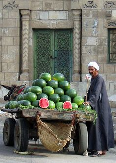 I have a photo almost exactly like this-summer-2006-Watermelon vendor, Cairo.