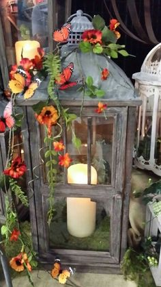 Cottage lantern accented with fern, pansies and butterflies.by Twigs Fall Lanterns, Garden Lanterns, Christmas Lanterns, Lanterns Decor, Candle Lanterns, Decorating With Lanterns, Hanging Lanterns, Candleholders, Candlesticks