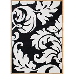 title='Ov...> - Hand-tufted Courtney's Leaves White Wool Rug (5' x 8') - Add a touch of style with this black and white hand-tufted and hand-carved wool rug 170.99featuring a floral design. With its plush pile height and swirling design, this rug is comfortable and beautiful. This 8-foot rug will pack a punch of panache.  www.overstock.com... $170.99