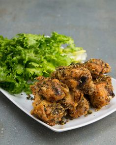 INGREDIENTS1 pound chicken wings2 teaspoons baking powder1 teaspoon saltGarlic Herb Sauce:3 tablespoons olive oil2 tablespoons minced garlic1 teaspoon dried basil1 teaspoon dried oregano1 teaspoon dried thyme1 tablespoon fresh parsley, chopped1 teaspoon salt1 teaspoon pepperPREPARATION1. Preheat oven to 400˚F/200˚C.2. Remove excess moisture from chicken wings with a paper towel. 3. In a large bowl, stir in baking powder and salt until chicken is thoroughly coated.4. Bake on a baking rack for… Baked Chicken Wings, Chicken Wing Recipes, Chicken Meals, Chicken Thighs, How To Cook Wings, Garlic Wings, Wings In The Oven, Yum Yum Chicken, Paleo Recipes