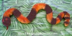 Slithering Snake Snack - An unusual Halloween twist on pigs in a blanket.