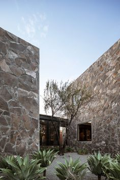 The offices of the Casa Leyros tequila distillery are located in stone buildings arranged around tranquil courtyards by Mexican firm 1540 Arquitectura.