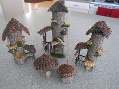 Tiny faerie houses from fat twigs, perfect for the corner of a glass terrarium with moss and a pebble path!