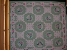 French Baskets Appliqued by Emma Daugherty; quilter unknown. Marie's first French Baskets quilt was made in 1914 with daisies instead of roses.  Her version with roses was introduced soon after, and became extremely popular.  This quilt was appliqued by Marie's sister, Emma, about 1930, during the time Emma lived with Marie and George Webster in Marion, at 926 South Washington Street, now The Quilters Hall of Fame.  part of the Webster Family Collection.