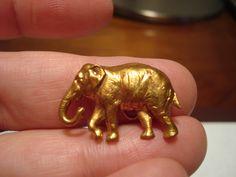 ButtonArtMuseum.com -  Antique Brass Realistic Elephant Button