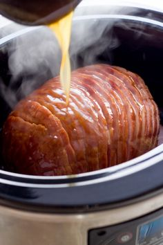 A recipe for honey mustard glazed ham cooked in a slow cooker.