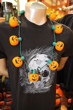 This LED light-up pumpkin necklace is a simple-yet-festive Halloween accent, especially if you want something easy to wear when attending Mickey's Halloween Party at Disneyland Resort. Look carefully to see a new Haunted Mansion-inspired shirt for this year.