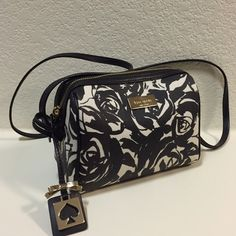 Kate Spade Small Floral Handbag Black and white, NEVER WORN, brand new, no tag, NWOT, long strap, pocket inside, super easy to zip, small bag, bigger than a makeup bag kate spade Bags Shoulder Bags