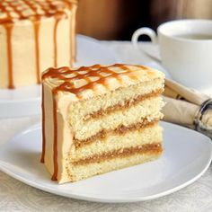 The Best Caramel Cake - A moist vanilla cake gets filled with layers of homemade caramel sauce and covered in caramel buttercream frosting. RECIPE
