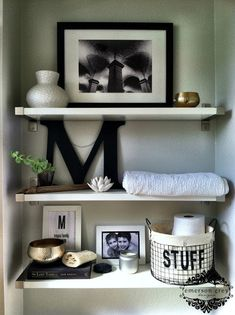 Styling shelves {our new home}, bathroom shelf styling, black and white with bits of gold.
