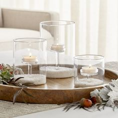 Shop Elsa Glass Tealight Holders.  Interior pedestal raises a single tea light to illuminating heights in Aaron Probyn's clever design that also allows for display of pebbles, seaglass or seasonal seeds and pods.