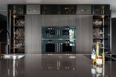 Poliform Artex in grey stained oak, integrated appliances from Gaggenau and Miele, tabletop in composite stone. Grey Stain, Bespoke Kitchens, Tabletop, Liquor Cabinet, Kitchen Design, Appliances, Stone, Furniture, Home Decor