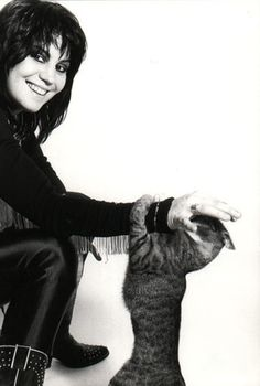 Joan Jett and cat friend...It wouldn't be going too far to call Joan Jett the last American rock star, pursuing her considerable craft for the right reason: a devotion to the true spirit of the music. She doesn't just love rock and roll; she honors it.
