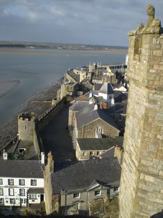 Looking from Caernarfon Castle across the Menai Strait to Anglesey. The Mermaid Inn just visible on the foreshore in Anglesey.  Wales