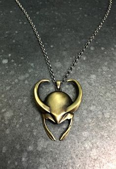 Loki Helmet Necklace by ReignMakers on Etsy