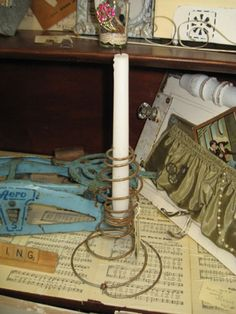 Old Bed Spring Candle Holder-by Margo:  I found these unusually shaped springs in this bed that I took apart. They just screamed to be made into candle holders.    I added a washer in between the tight spring area in the center, and a little glue to keep it in place, and the candle just sits on it.      Springs in Spring