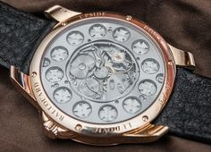 """Ludovic Ballouard Upside Down Watch With Pearl Dial Hands-On by Rob Nubbs """"They say you should never meet your heroes, and in regards to the often eccentric characters of horology, the adage may be wiser still. But when it comes to the man behind the Ludovic Ballouard Upside Down watch, it's worth throwing caution to the wind. We met Ludovic a few weeks ago and went hands-on with the top-of-the-range model that sports a mother of pearl dial, making it a stylish watch that grabs your…"""