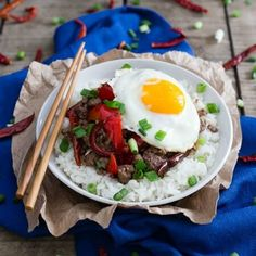 This spicy beef and red pepper rice bowl is cooked with dried red chili peppers and topped with a runny egg for a quick and easy dinner.