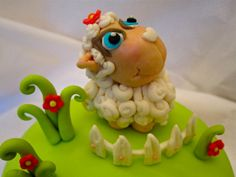 I used nadia's new book to make this little sheep, i had to modify the face because I'm afraid i wasn't good enough to do her version! The book is amazing! and can totally recommend it, especially if you want animals with a cute little twist,. Fondant Toppers, Fondant Cakes, Cupcake Cakes, Sheep Cake, Jumping Clay, Cool Cake Designs, Fondant Animals, Novelty Cakes, Gum Paste