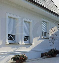 Residential rolling door window security shutters shade shutter systems inc home - The rolling shutter home in bohemia ...