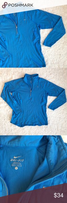 "Nike Dri Fit Blue Quarter Zip Running Long Sleeve Nike Dri Fit Blue Quarter Zip Running Long Sleeve. Side and back mesh paneling. Great pre used condition with no flaws. Size L - Length 26"", Bust (armpit to armpit) 20"". ❌NO trades/modeling. Offers welcomed. Nike Tops"