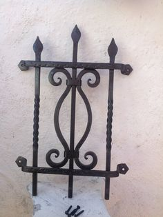 Speakeasy Grille Wrought iron, handmade rustic and heavy Available in black and oiled bronze painted finish Four fancy black pyramid mounting